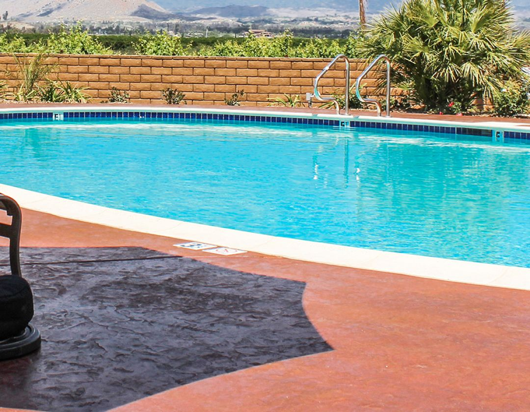 The refreshing outdoor pool of at Couple drinking red wine at Carter Estate Winery and Resort